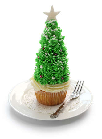 homemade christmas tree cupcake isolated on white background photo