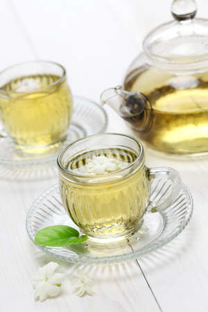 jasmine tea with arabian jasmine flower photo