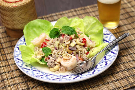 spicy lemongrass salad, yam takrai, thai cuisine photo
