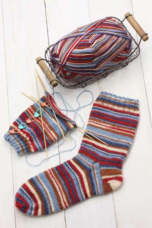 balls of yarn: knitting winter warm socks, yarn ball and knitting needles, handmade christmas present