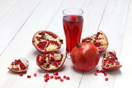 fresh pomegranate fruits and juice photo