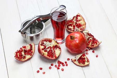 pomegranate fruits, pomegranate juice and juice press photo