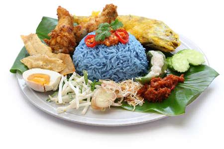 nasi kerabu, blue color rice salad, traditional malaysian cuisine isolated on white background