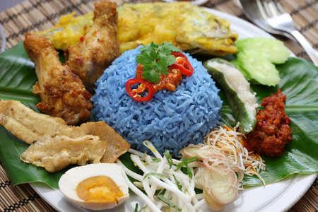 nasi: nasi kerabu, blue color rice salad, traditional malaysian cuisine