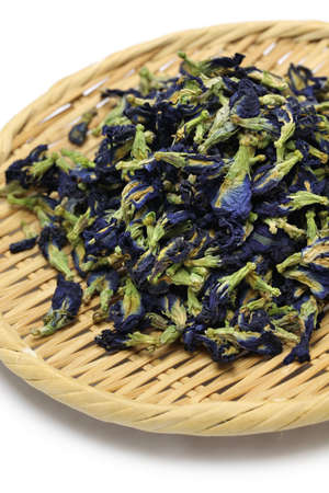dried butterfly pea flowers on bamboo basket photo