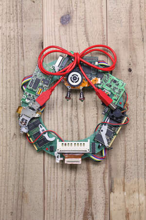 geeky: geeky christmas wreath made by old computer parts hanging on wooden door, computer parts recycling idea