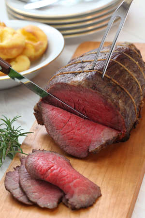 beef cuts: roast beef carving, sunday dinner Stock Photo