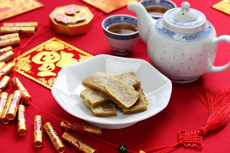 chinese new year decoration: nian gao, chinese new year rice cake, pan fried and dipped in egg