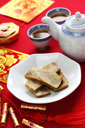 rice cake: nian gao, chinese new year rice cake, pan fried and dipped in egg