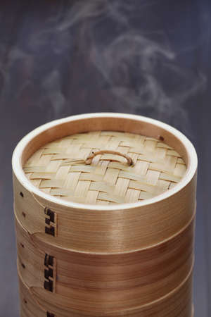 unknown: yum cha, dim sum, chinese food in bamboo steamer, unknown contents Stock Photo