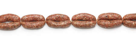 stuffer: chain of raw sausages isolated on white background