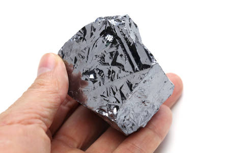 hand holding polycrystalline silicon, polysilicon
