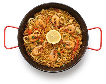 marisco: fideua de marisco, seafood pasta paella, spanish cuisine isolated on white background Stock Photo