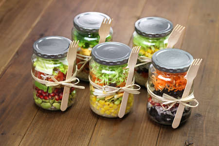 salads: homemade healthy salad in glass jar