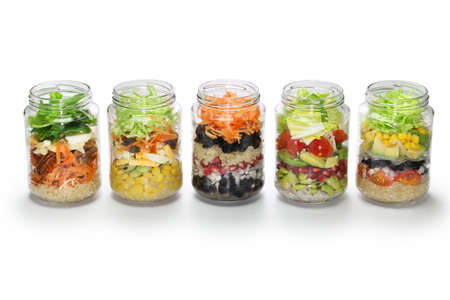 homemade vegetable salad in glass jar on white background, no lid Stock Photo