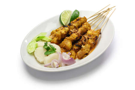 chicken satay with peanut sauce, indonesian skewer cuisine isolated on white background