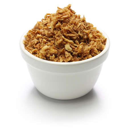 crispy fried onion flakes on white background