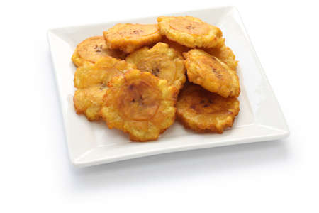 rico: tostones, patacones, fried green plantain banana chips on white background