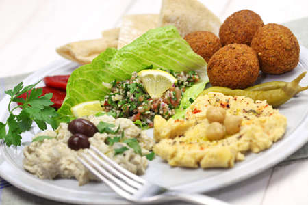 hummus, falafel, baba ghanoush, tabbouleh and pita, middle eastern cuisine Stock Photo