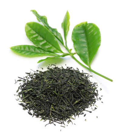heap of japanese green tea with young leaves on white background