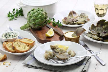 eating boiled artichoke italian cuisine