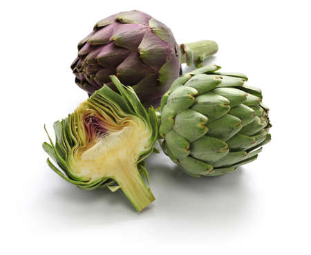 whole and half cut artichoke isolated on white background Stock Photo