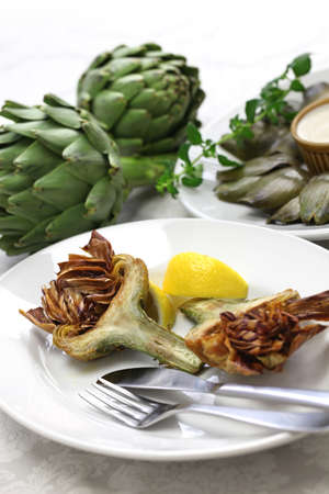 jewish cuisine: deep fried artichoke roman jewish cuisine carciofi alla giudia Stock Photo