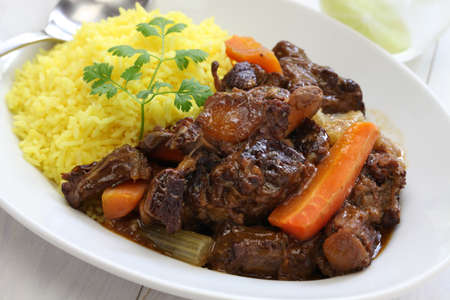 Cuban oxtail stew with yellow rice rabo encendido