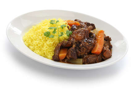 Cuban oxtail stew with yellow rice rabo encendido isolated on white background Stock Photo