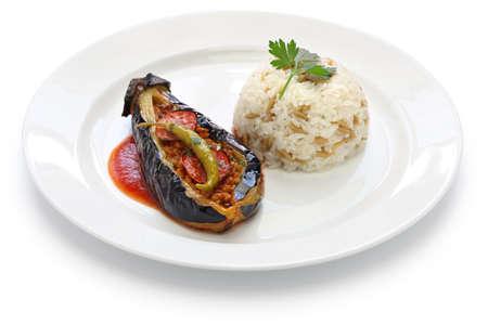 belly pepper: karniyarik pilav stuffed eggplant with pilaf turkish cuisine isolated on white background Stock Photo