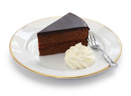 slice of cake: homemade sachertorte Austrian chocolate cake isolated on white background Stock Photo