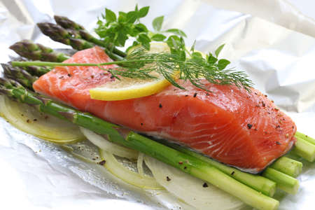 dill: fresh salmon with asparagus in foil paper ready for cooking
