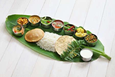 バナナの葉は、伝統的な南インド料理のお食事 写真素材