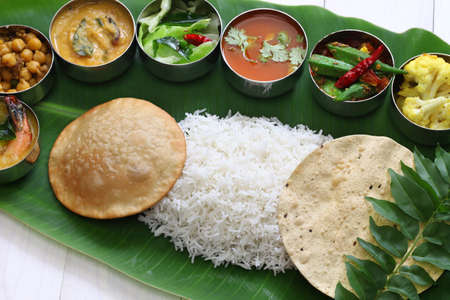 food dish: meals served on banana leaf, traditional south indian cuisine