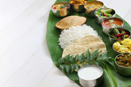 spicy food: south indian meals on banana leaf