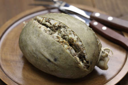 scottish: homemade haggis, scotland food isolated on wooden background