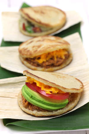 colombian food: Arepas, venezuelan-colombian corn bread sandwich