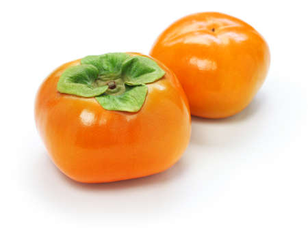 Jiro kaki, japanese persimmon on white background 스톡 콘텐츠