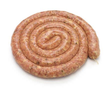pork sausage: raw cumberland sausage, spiral pork sausage on skillet isolated on white background