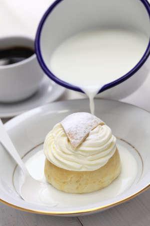 marzipan: semla in a bowl of warm milk, hetvagg Stock Photo