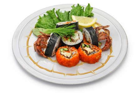 maki sushi: Spider roll, maki sushi made of soft shell crab tempura and sushi rice.