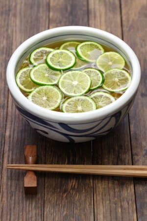 buckwheat noodle: sudachi soba buckwheat noodles with sliced japanese citrus, japanese food
