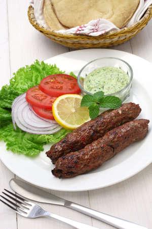 pita bread: mutton seekh kabab with mint chutney Stock Photo