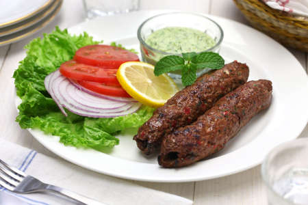 food dish: mutton seekh kabab with mint chutney Stock Photo