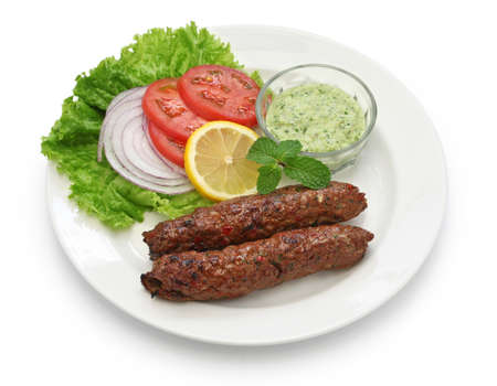 lamb: mutton seekh kabab with mint chutney isolated on white background