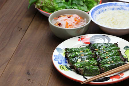 betel leaf: grilled minced beef wrapped in betel leaf, vietnamese cuisine, thit bo nuong la lot Stock Photo