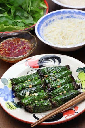 bo: grilled minced beef wrapped in betel leaf, vietnamese cuisine, thit bo nuong la lot Stock Photo