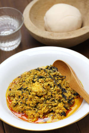 red palm oil: egusi soup and pounded yam, nigerian cuisine