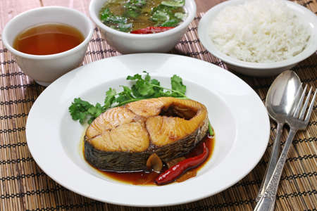 seer: com ca thu kho, rice with king mackerel simmered in caramelized sauce, vietnamese cuisine