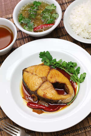 sliced: com ca thu kho, rice with king mackerel simmered in caramelized sauce, vietnamese cuisine